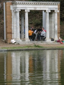 View Across Pond of Zaptet Woodwind Quintet Performing at Portal of the Past, Golden Gate Park, San Francisco
