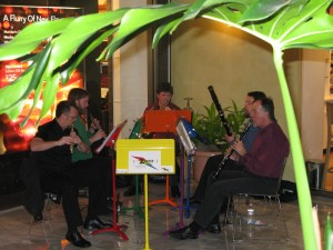 Zaptet Woodwind Quintet Performing Under Plant Frond at Stonestown Galleria in San Francisco
